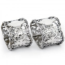Pair of Antique Silver Oval Napkin Rings Pierced with Scrolls and Applied Floral Border