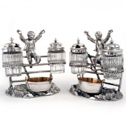 Pair of Victorian Boy on a Fence Silver Plate Cruet Sets. Circa 1880
