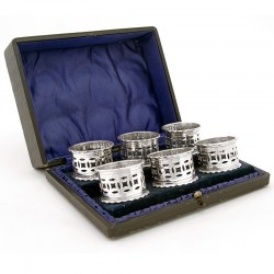Six Boxed Silver Plated Napkin Rings with Pierced Galleries c.1900