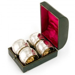 Four Boxed Antique Silver Plated Napkin Rings with Guilding. Circa 1895