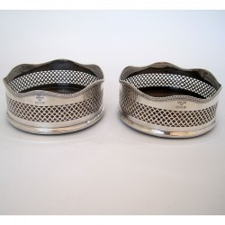 Pair of Georgian Style Silver Coasters with Pierced Bodies and Wooden Bases