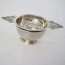 Silver Tea Strainer and Bowl with Two Pierced Keyhole Style Handles