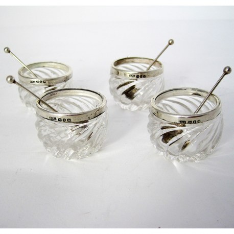 Four Late Victorian Silver and Glass Salts with Matching Spoons (1891)
