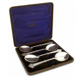 Set of Four Boxed Victorian Silver Plate Serving Spoons Chased with a Grape and Vine Pattern (c.1890)