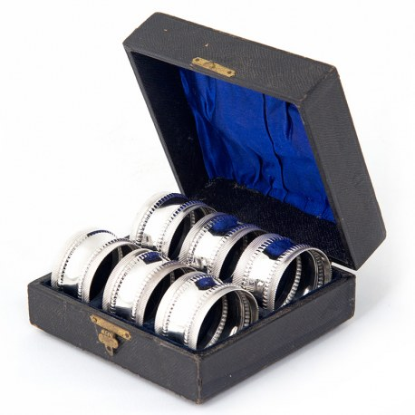 Set of six silver plated napkin rings in their original blue silk lined box