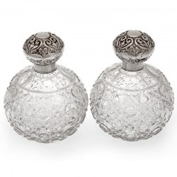 Pair of Antique Globe Shaped Silver Top Perfume Bottles with Hob Cut Glass Bodies