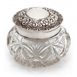 Edwardian dressing table jar with a hinged silver floral and flower repousse decorated lid
