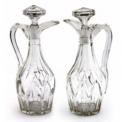 Pair of Victorian Cut Glass Claret Jugs with Deep Cut Bodies and Applied Scroll Handles