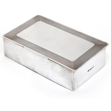 Silver Cigar or Cigarette Box with a Hinged Lid and Engine Turned Border with a Plain Panel