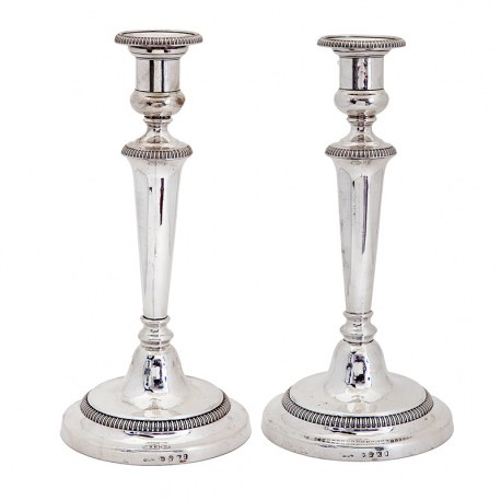 Pair of Handsome George III Silver Candle Sticks with Plain Tapering Stems and Spreading Circular Base