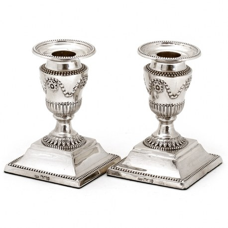Pair of Edwardian Silver Dwarf Candlesticks with Garland and Fluted Capitals Leading to Circular Acanthus Style Collar