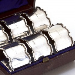 Boxed Set of Six Silver Napkin Rings with Plain Bodies and Chippendale Style Borders