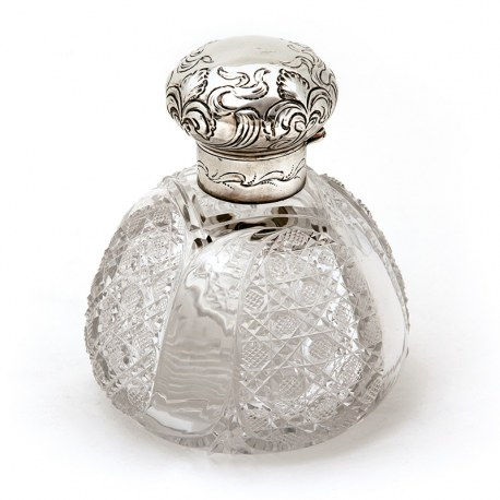 Large Late Victorian Silver Topped Perfume Bottle with a Hinged Repousse Floral Scroll Decorated Lid