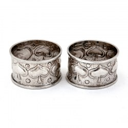 Pair of Arts and Crafts Style Silver Napkin Rings Chased with Stylised Foliage