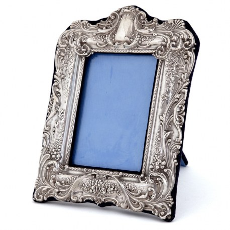 Antique Silver Photo Frame Decorated in High Relief with Stylised Fruit, Flowers and Scrolls