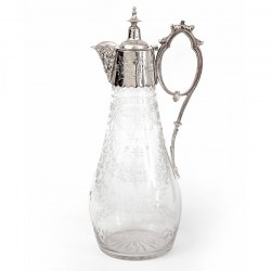 Antique Silver Plated Claret Jug with a Cast Floral Spout and Hand Engraved Glass Body