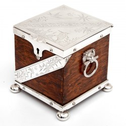 Antique Tea caddy with an Oak Body and Silver Plated Mounts (c.1885)