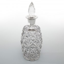 Heavy Silver Mounted Decanter with a Glass Barrel Shaped Body and Deep Star Cutting