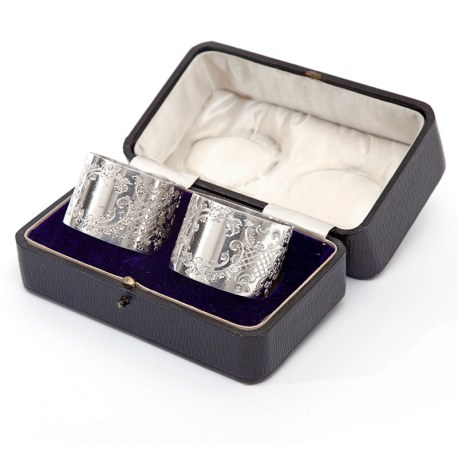 Pair of Boxed Edwardian Silver Napkin Rings with a Floral and Scroll Patern