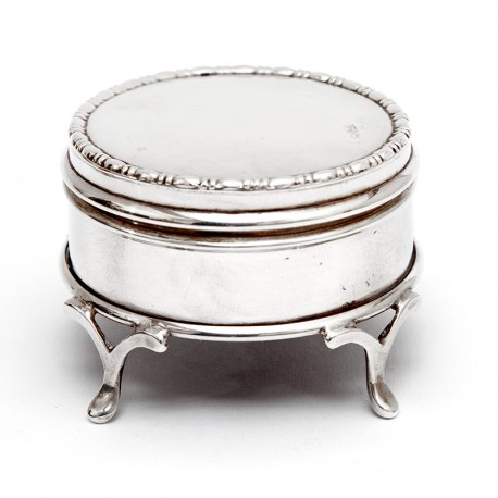 Small Circular Silver Jewellery Box with a Plain Body and Mauve Velvet Lining