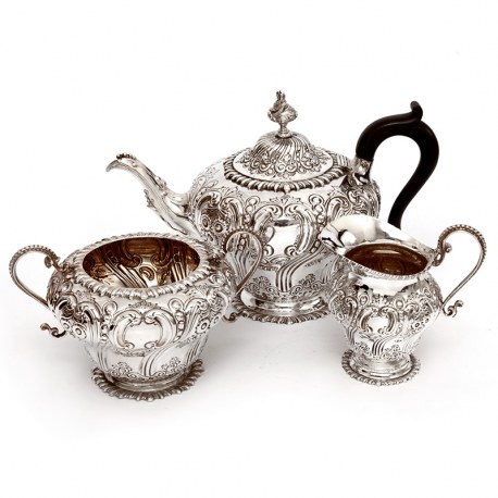 Late Victorian Three Piece Silver Tea Set Chased with Flowers and Scrolls