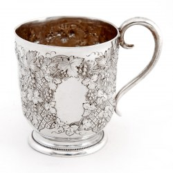 Victorian Silver Christening Mug with a Grape and Vine Pattern and Scroll Handle